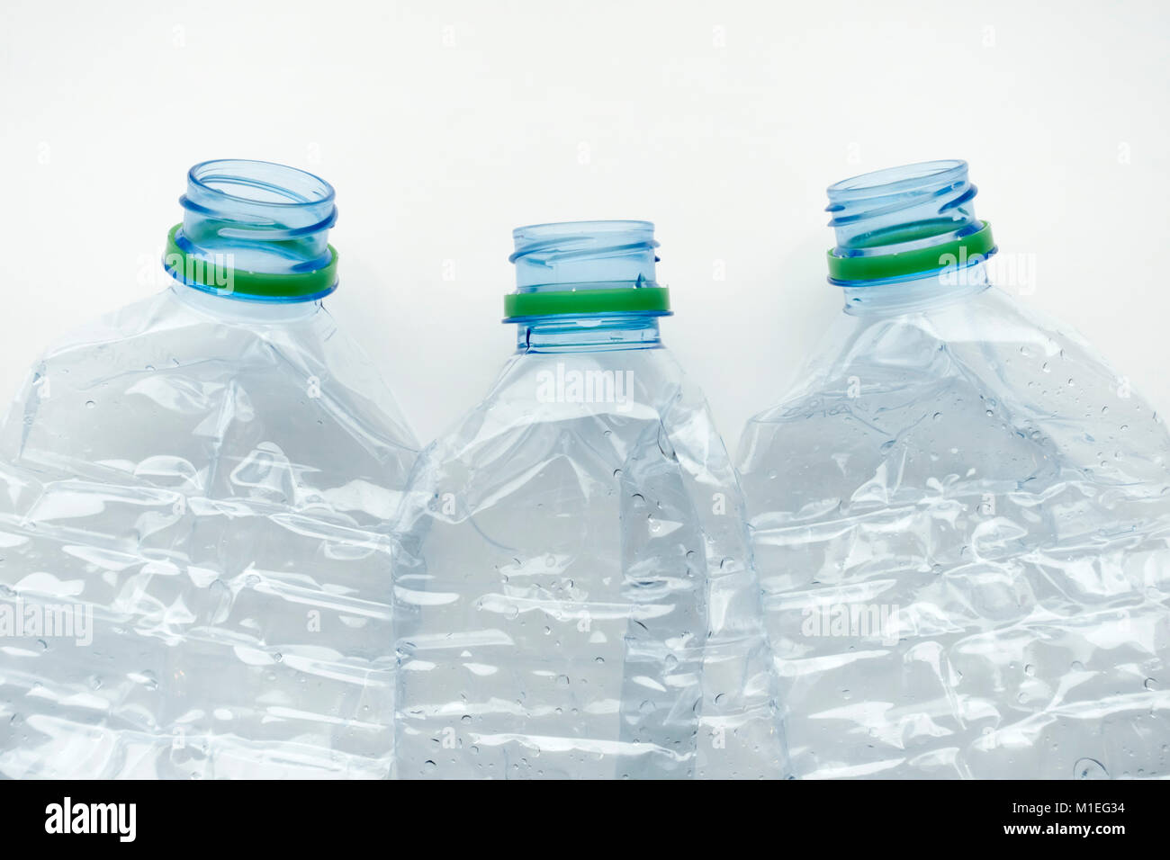 Three empty crushed plastic water bottles Stock Photo