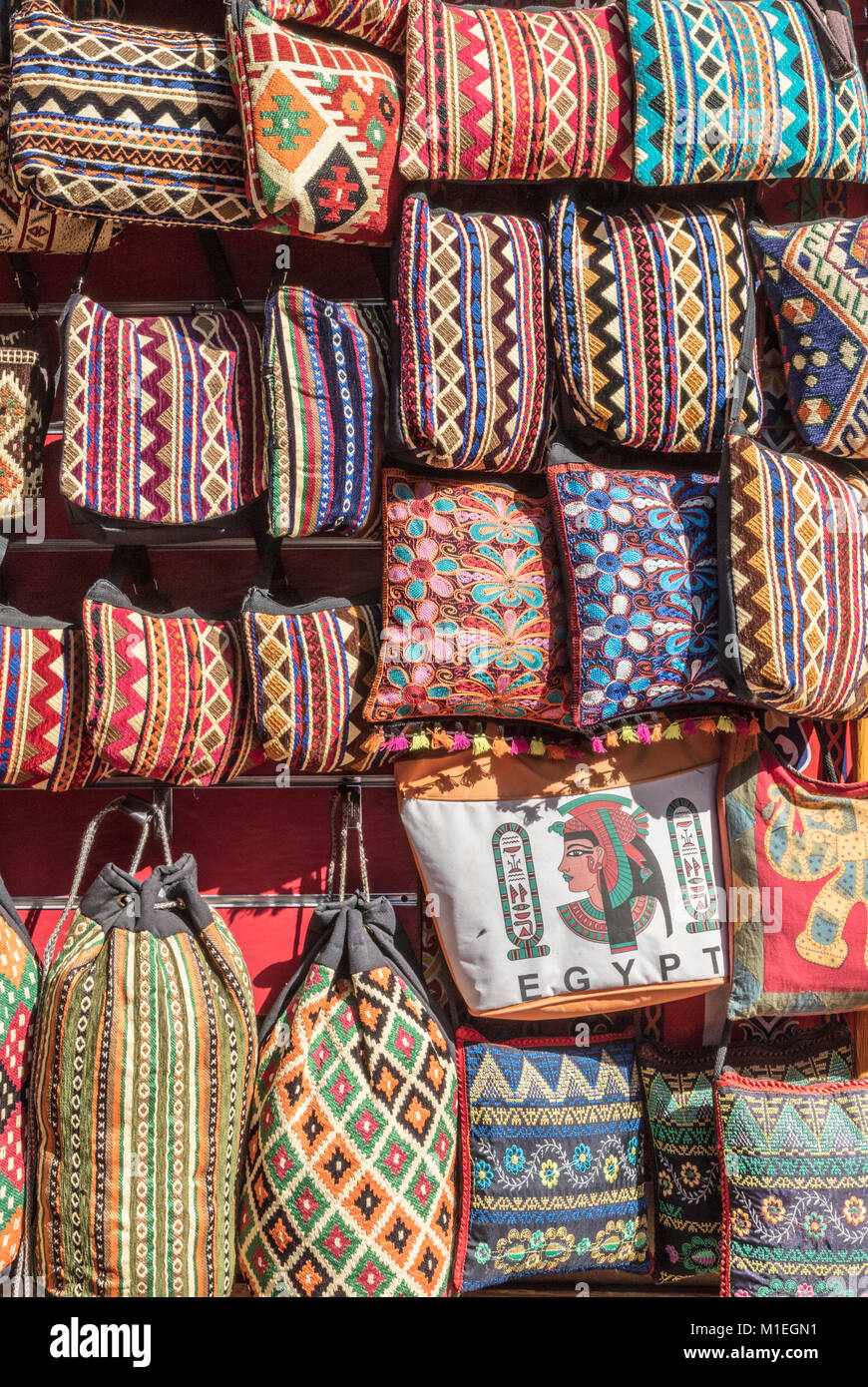 Brightly colored embroidered purses on sale at the souk, Aswan, Egypt - Stock Image