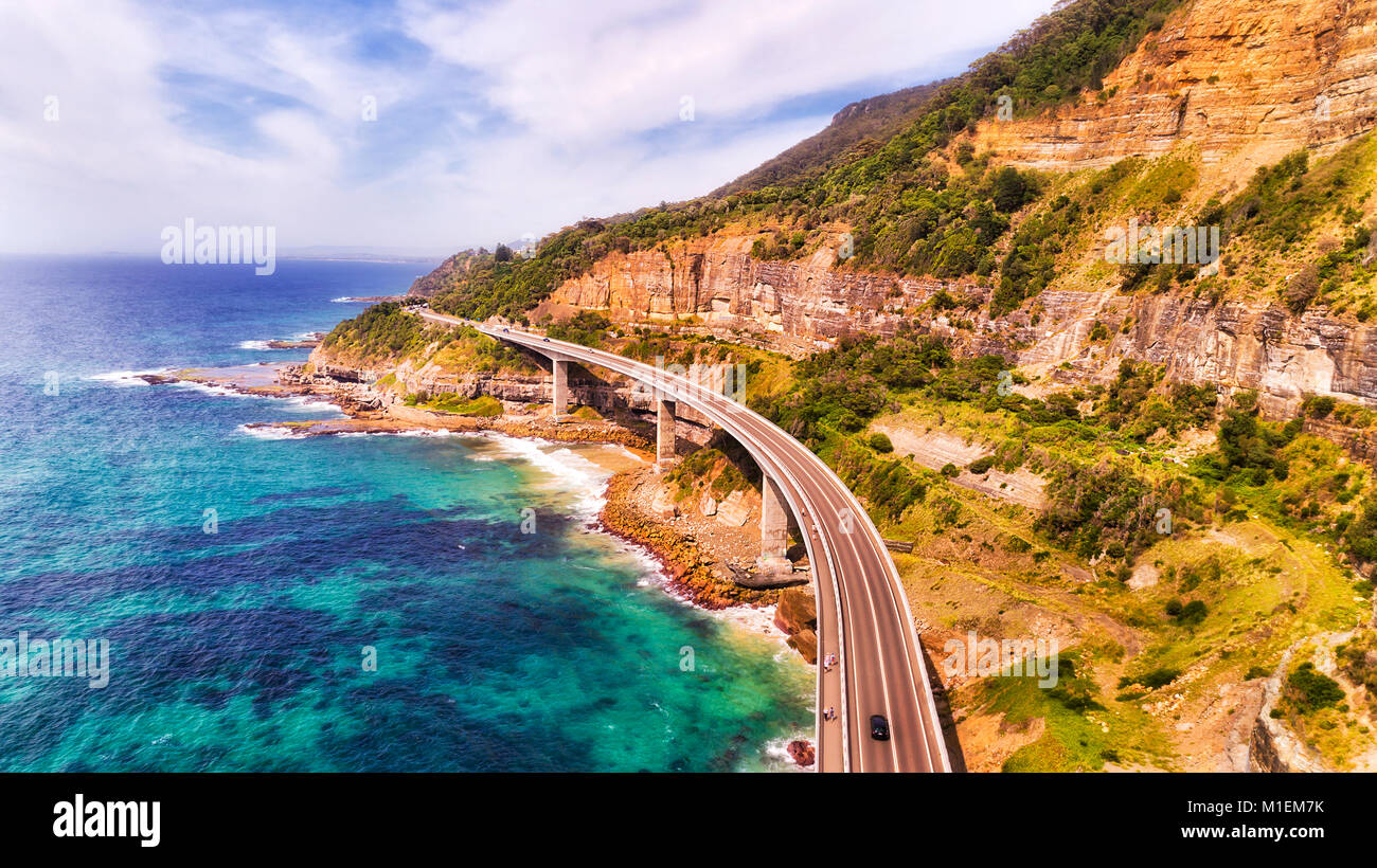 Unique Sea Cliff Bridge on the Grand Pacific drive in NSW on a sunny summer day southbound elevated mid-air view - Stock Image