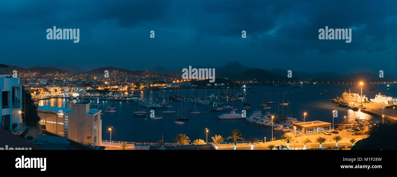 Mindelo in twilight. Port town with many boats in the bay on the Cape Verde in the northern part of the island Sao - Stock Image