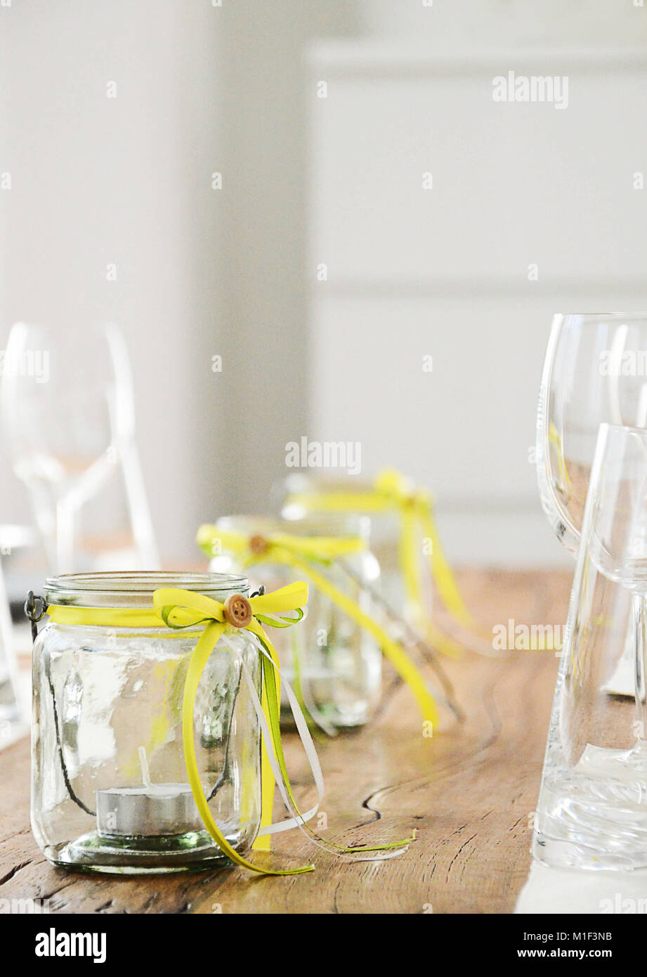 Glass Jar With Tea Candles Inside Table Decoration In Yellow And