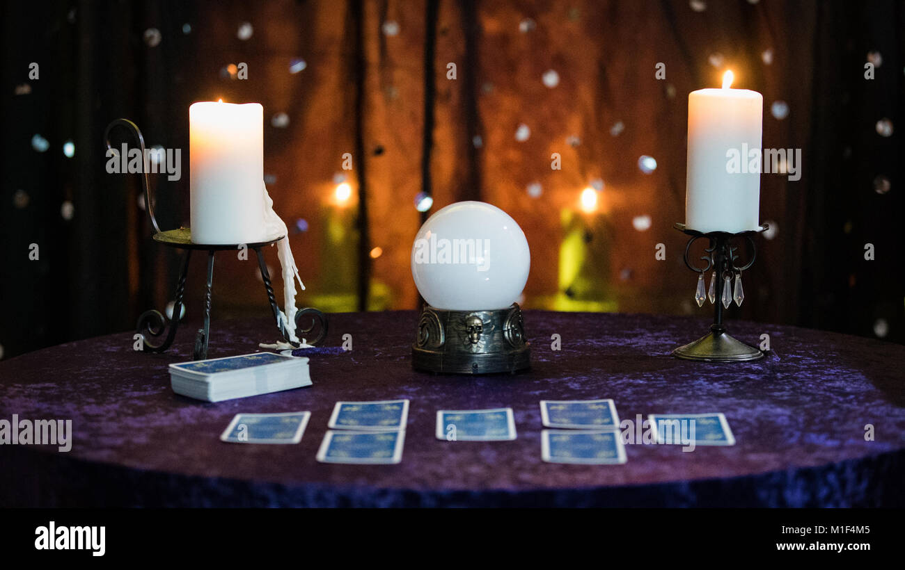 Fortune Telling Table with a Crystal Ball and Tarot Cards Stock Photo