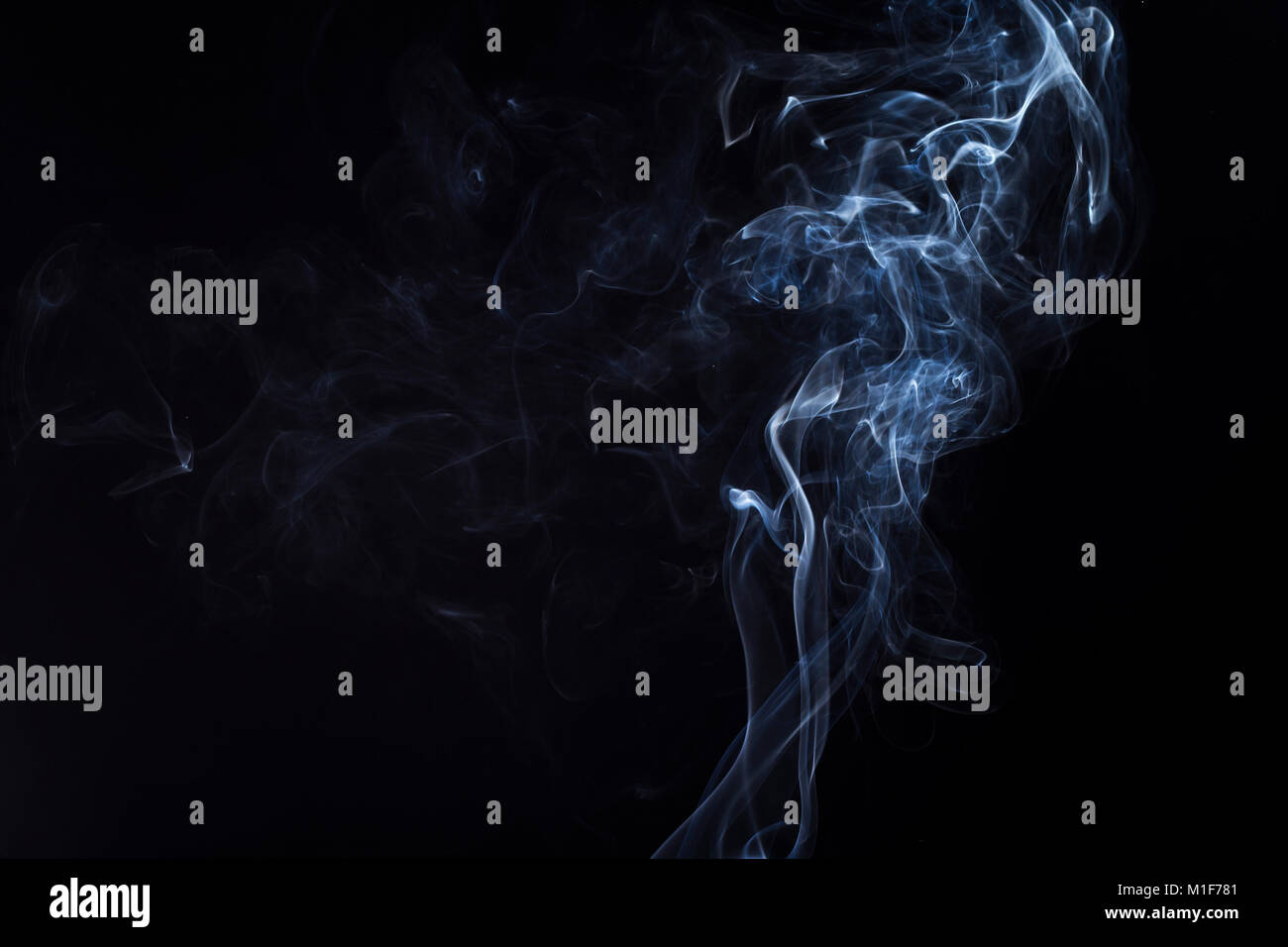 Swirly cloud of smoke on black background, used for design and as various graphic resource - Stock Image