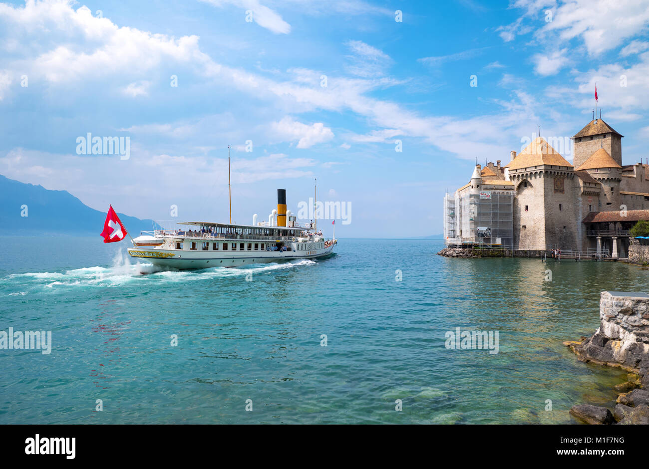 Montreux, Switzerland,  A boat with tourits reaching the Chillon castle on the Leman lake - Stock Image