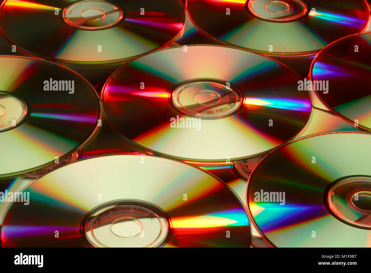 Colourful refraction effects on DVDs Stock Photo