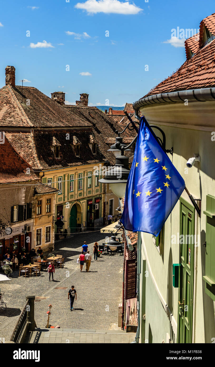 Eu Flag Flying Above A Street In Medieval City Of Sibiu Romania Stock Photo Alamy