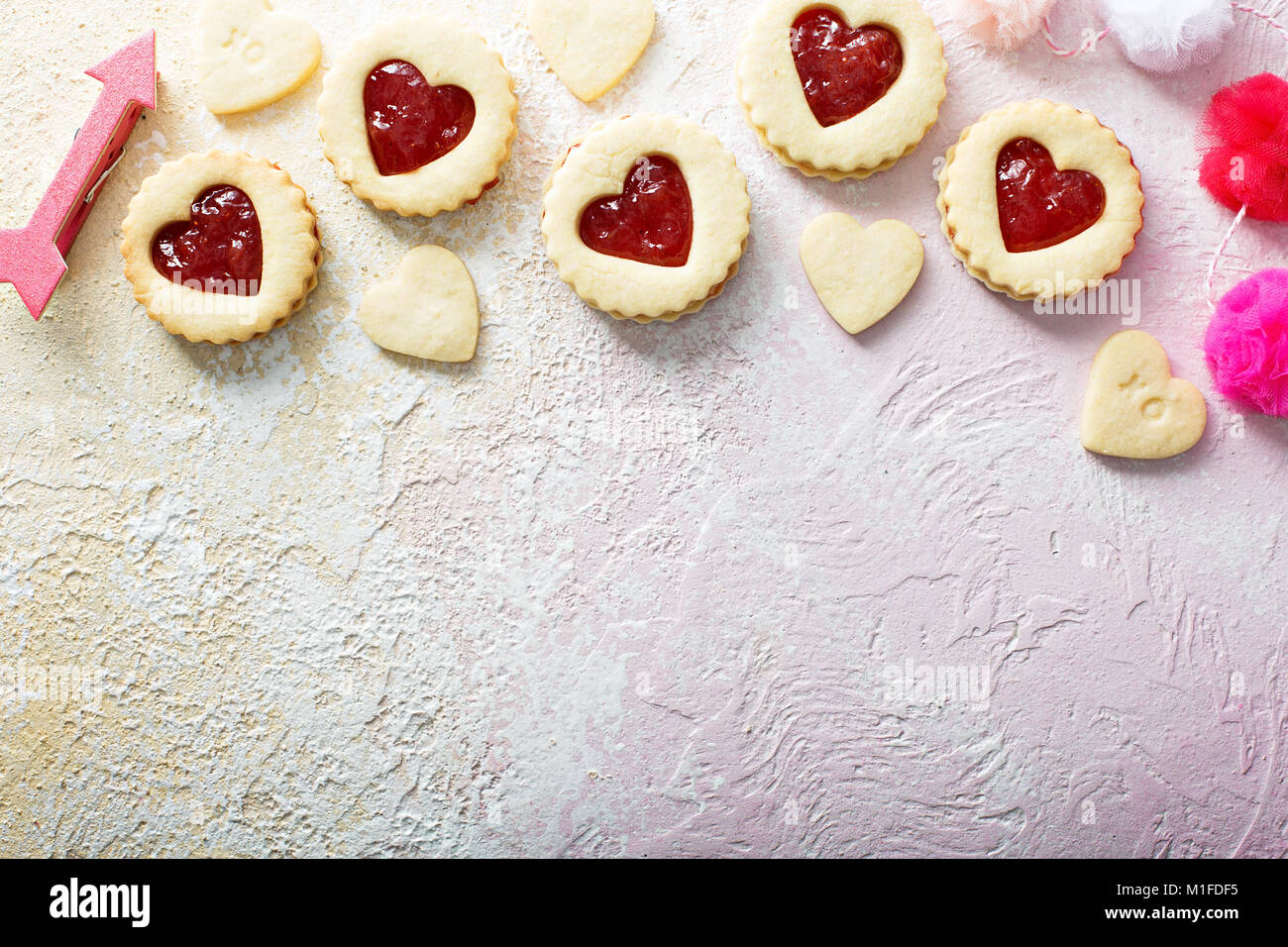 Vanilla cookies with strawberry jelly filling for Valentines Day with copy space - Stock Image