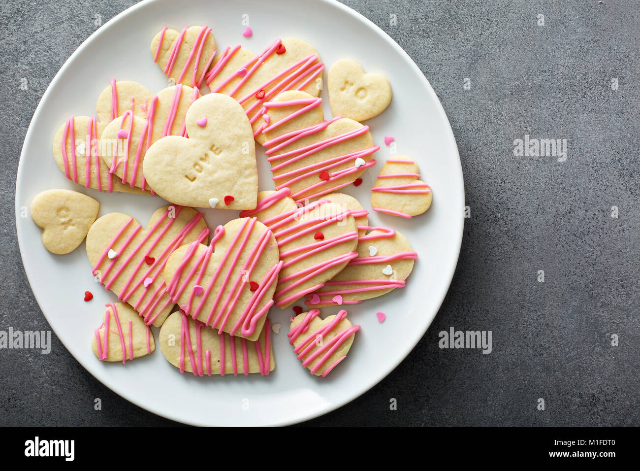Vanilla Sugar Cut Out Cookies With Pink Glaze And Sprinkles For