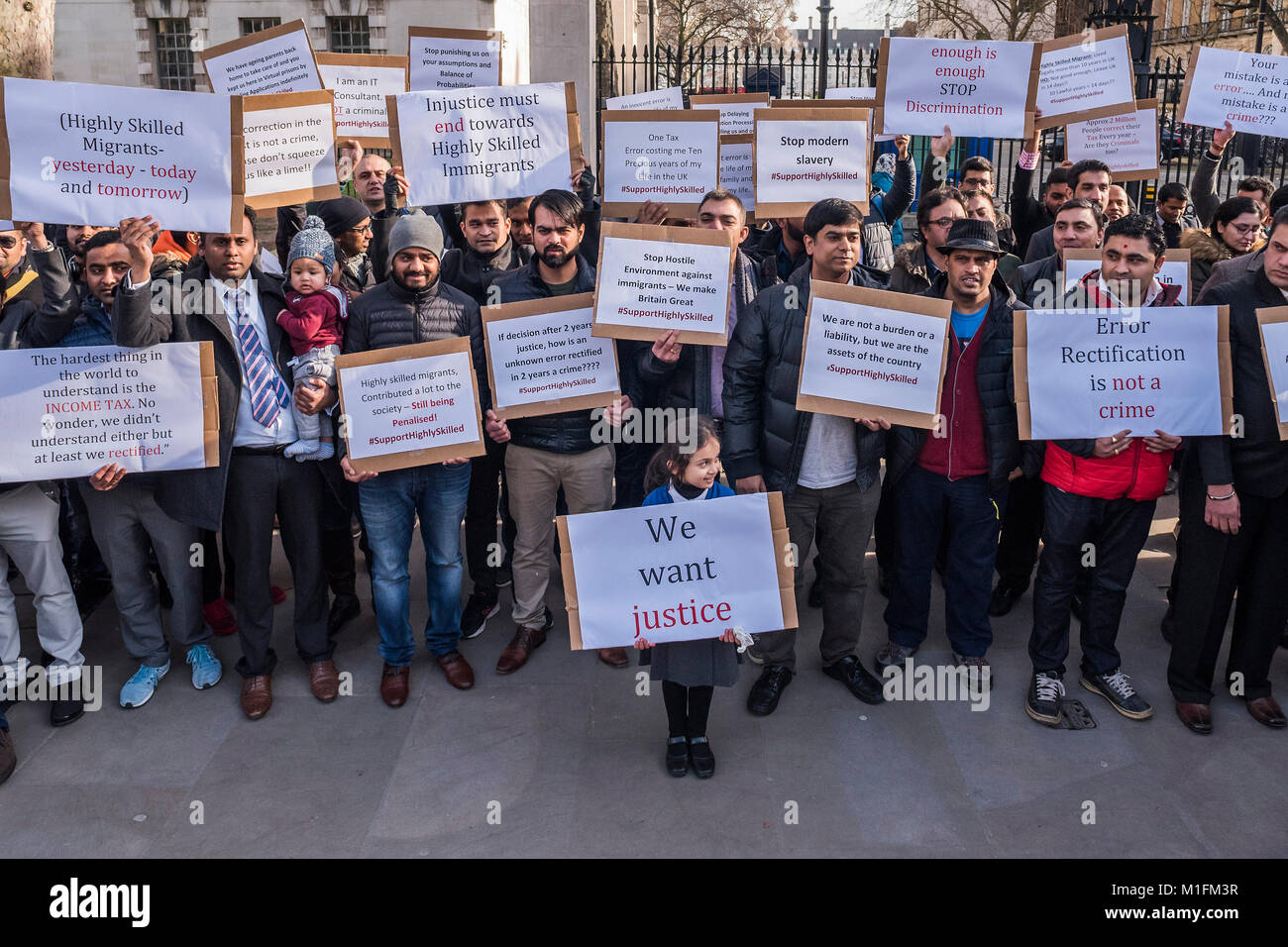 London, UK. 30th January, 2018. A group calling themselves 'Highly Skilled Migrants UK' protest in Whitehall about Stock Photo