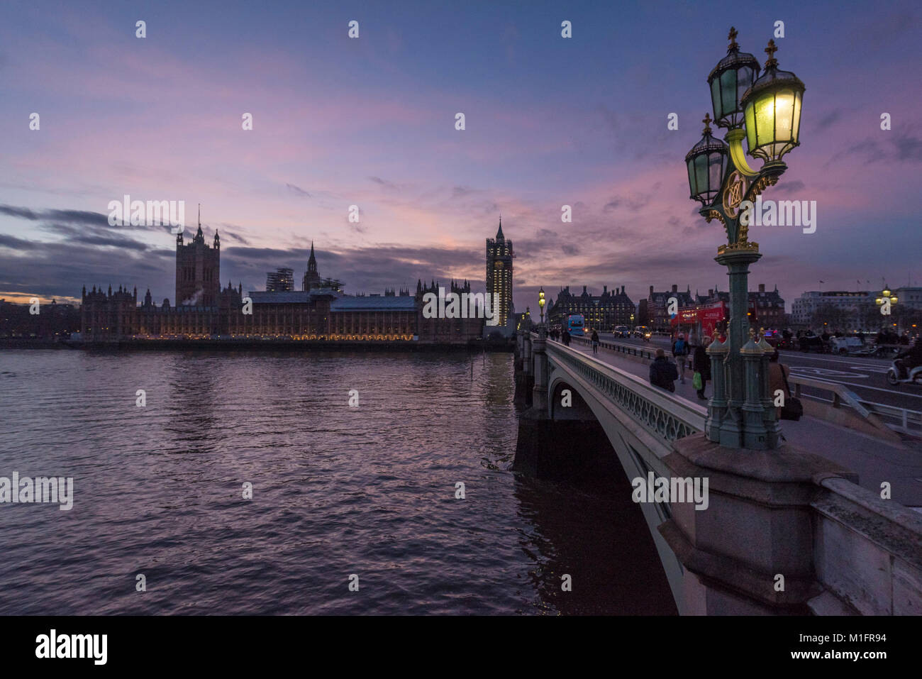 London, UK.  30 January 2018.  UK Weather:  The sun sets behind The Houses of Parliament in Westminster, which is Stock Photo