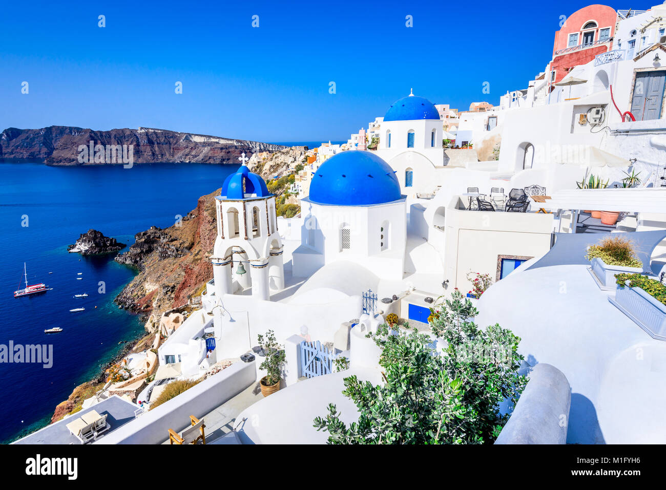 Oia, Santorini - Greece. Famous attraction of white village with cobbled streets, Greek Cyclades Islands, Aegean Stock Photo