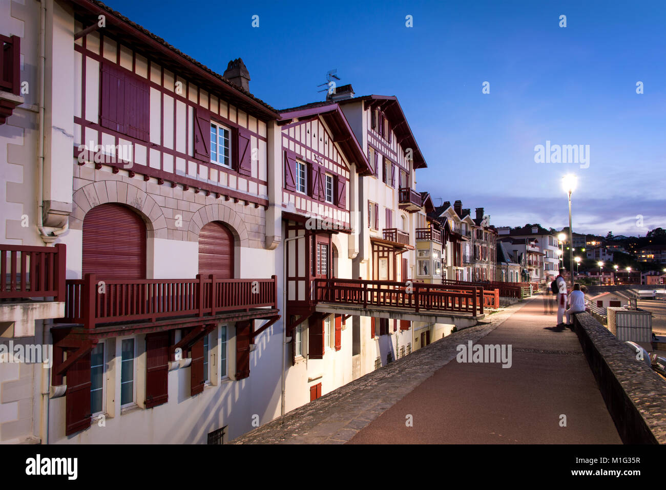 Traditional labourdine houses of Saint de Luz at night, Basque Country, France - Stock Image