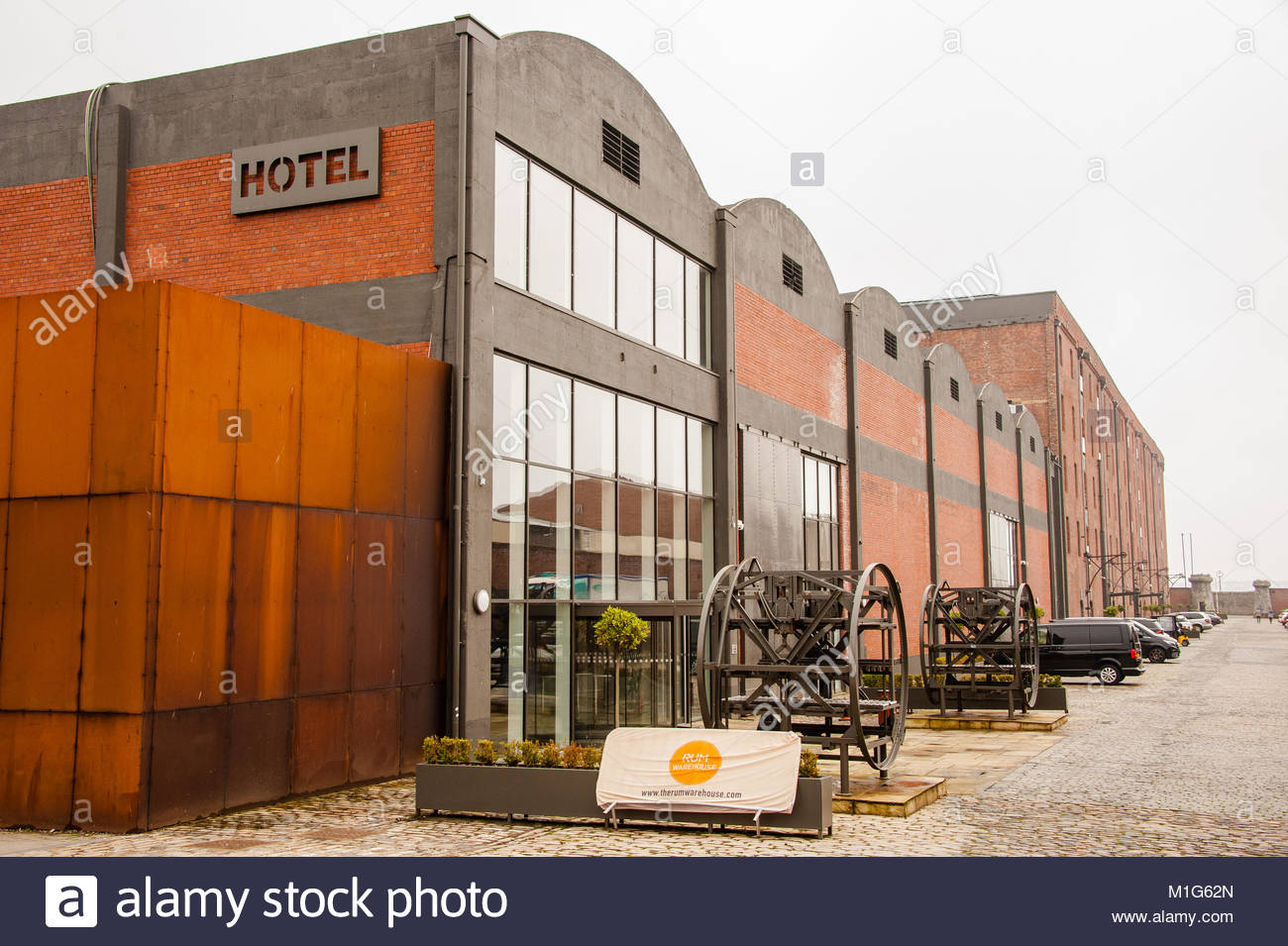The back of the Titanic Hotel in Liverpool showing the entrance to the Rum Warehouse conference, events and banqueting Stock Photo