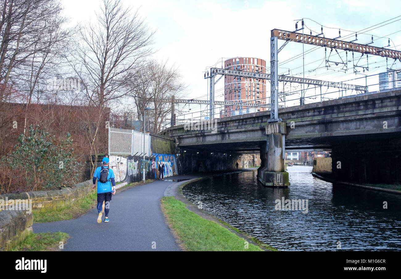 Leeds Yorkshire UK - Runner on the Riverside Aire Valley towpath by the city centre canals - Stock Image