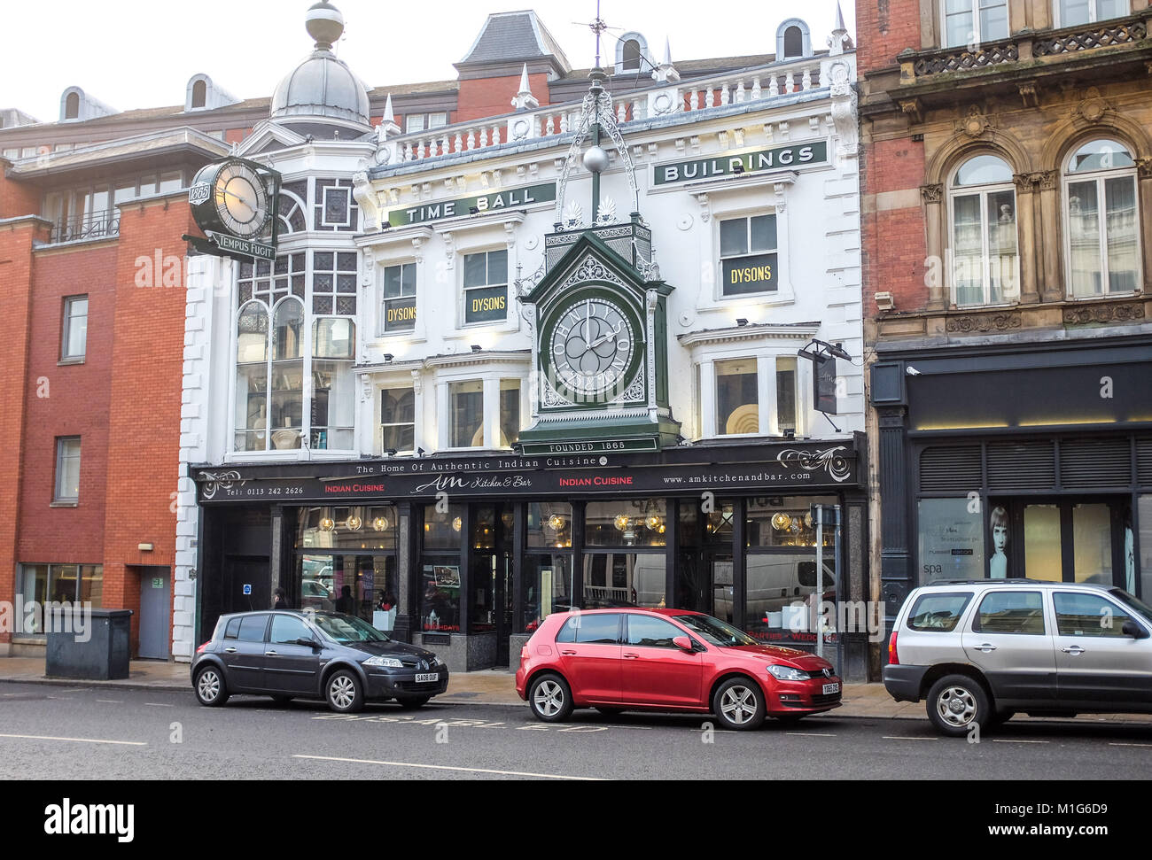 Leeds Yorkshire UK - The Dysons Time Ball Buildings   On the top and front of his premises are two large electric - Stock Image
