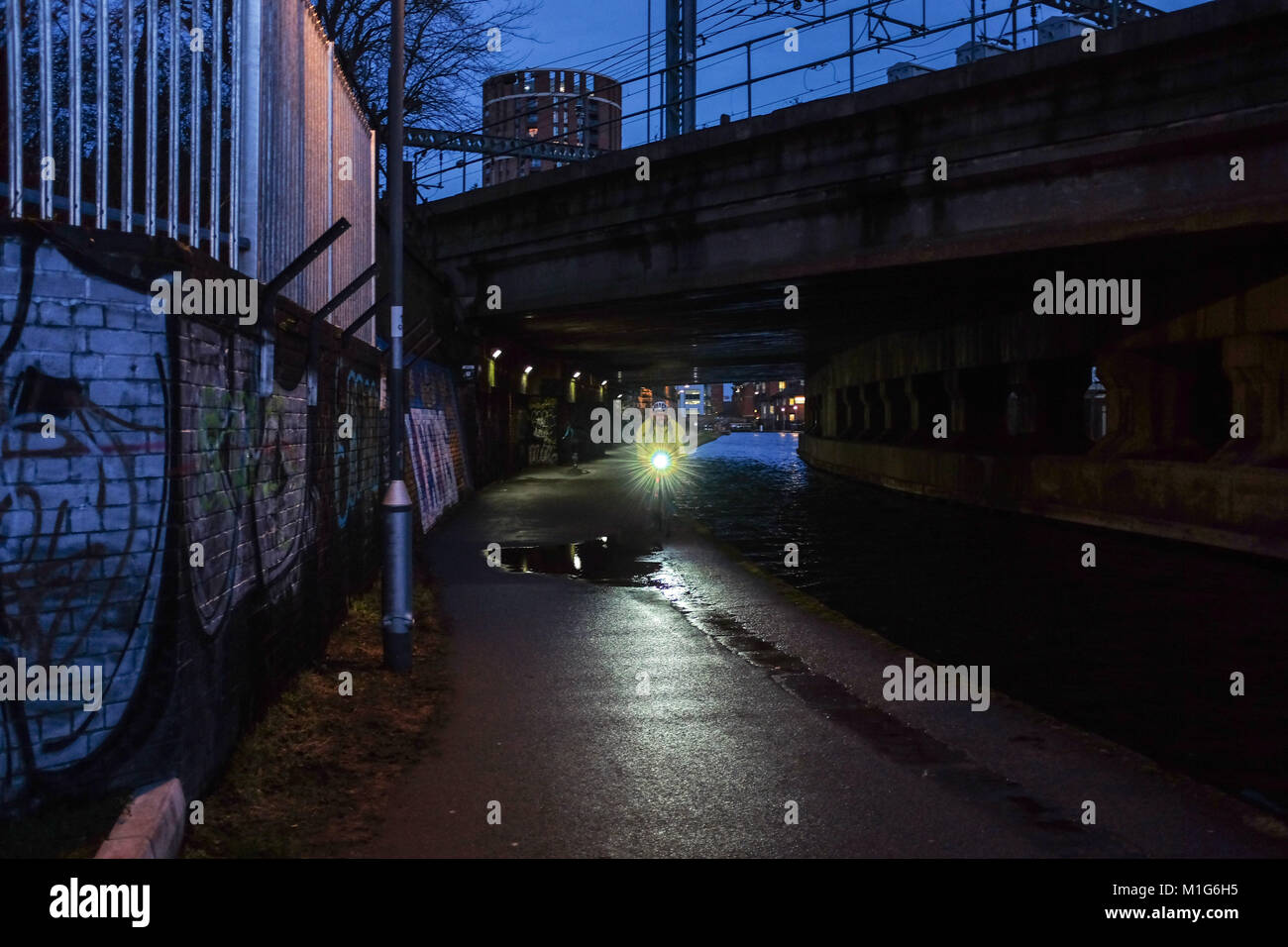 Leeds Yorkshire UK - Cyclist on the Aire Valley canal towpath Photograph taken by Simon Dack - Stock Image