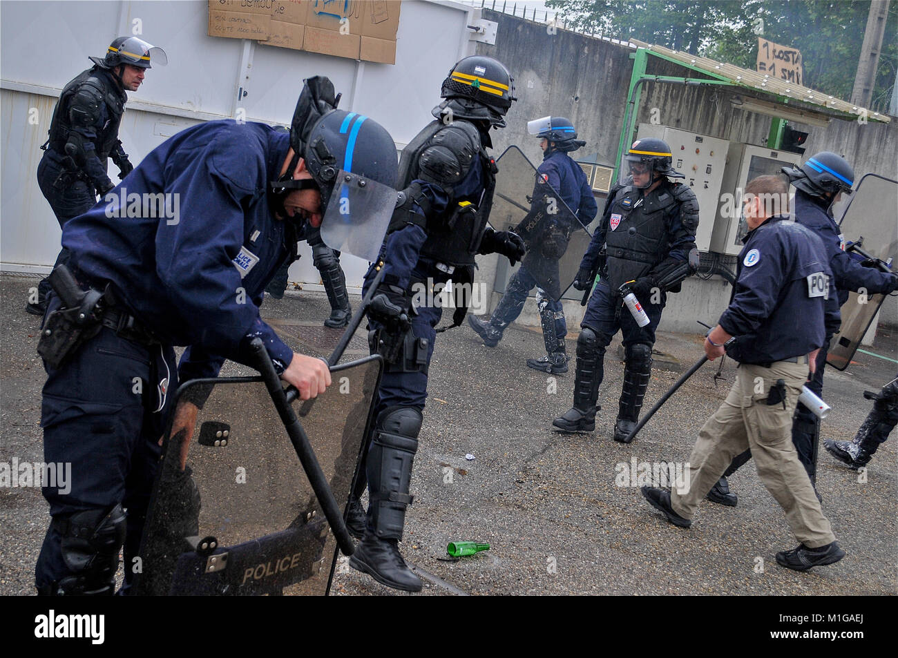 Police officers protect ARKEMA industrial site from protesters intrusion, Pierre-Benite, France - Stock Image