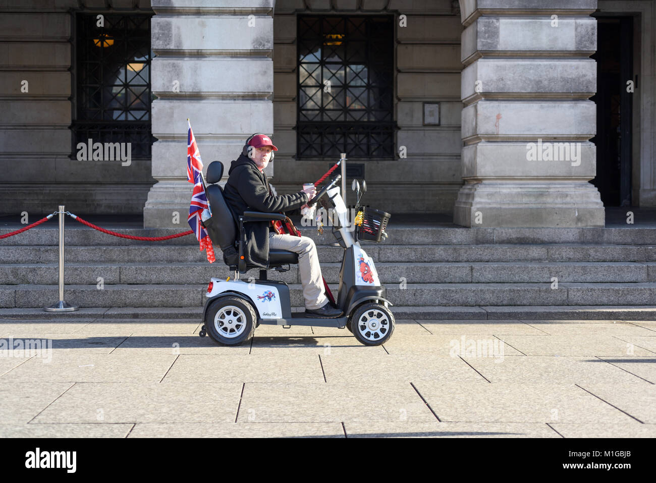 Disability Scooter rider Old Market Square Nottingham,UK. - Stock Image