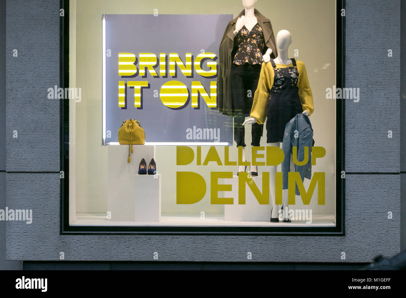 Clothing store shop window displays showing the latest retail products on sale, Liverpool, United Kingdom - Stock Image