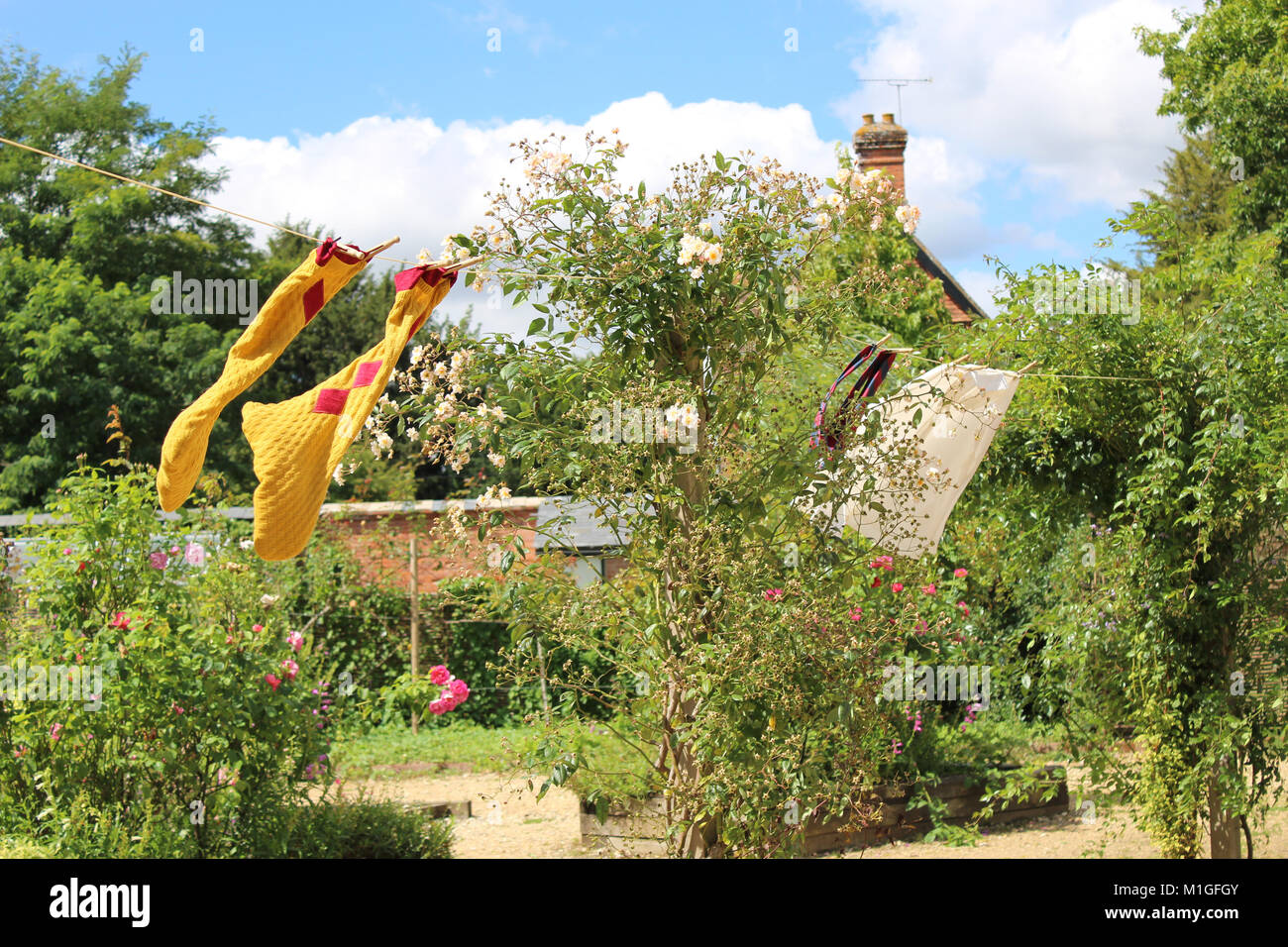 A giant's clothes drying on the washing line at the National Trust property, Mottisfont, in Romey. - Stock Image