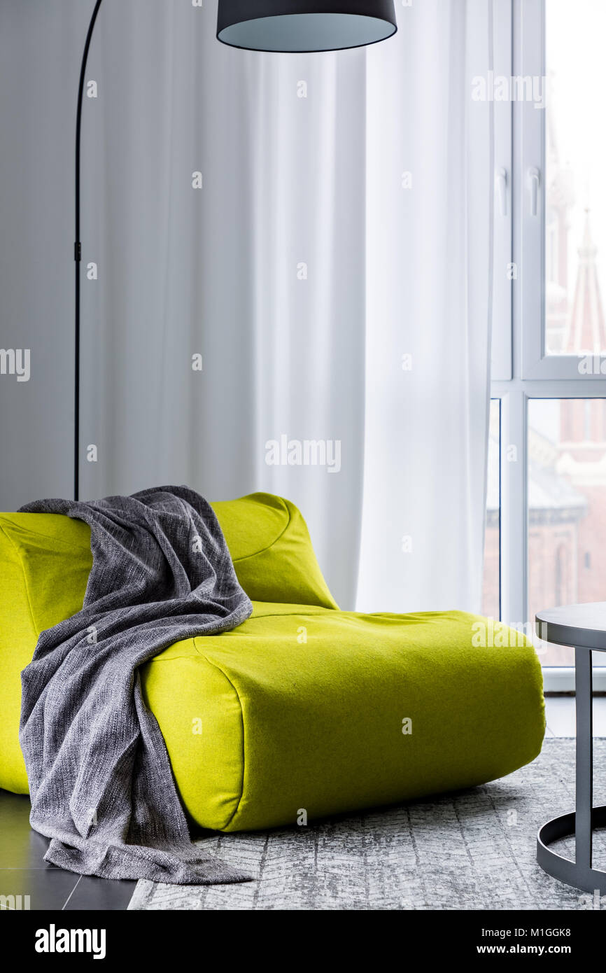 Home interior with new green bean bag sofa Stock Photo