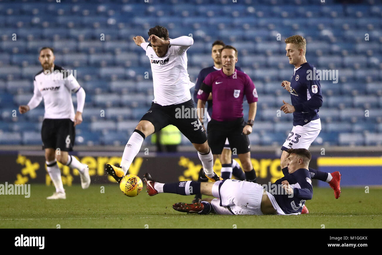 Derby County's George Thorne (left) battles for possession of the ball with Millwall's Jake Cooper during - Stock Image