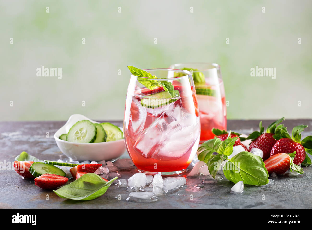 Refreshing spring or summer cocktails with strawberry, basil and cucumber - Stock Image