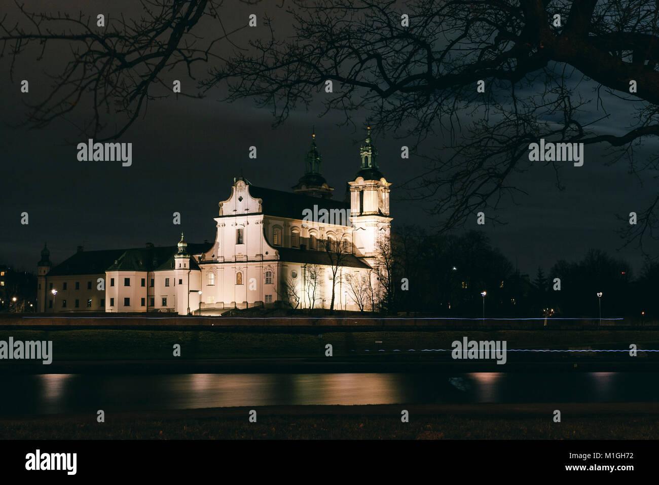 Na Skałce Church in Krakow, Poland reflected in the river Vistula at night - Stock Image