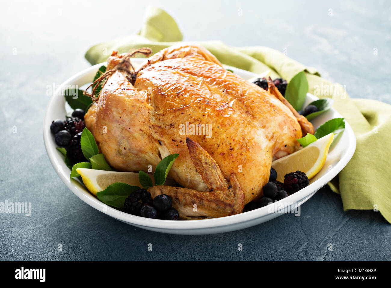 Roasted chicken with lemon and herbs for holiday or sunday dinner - Stock Image