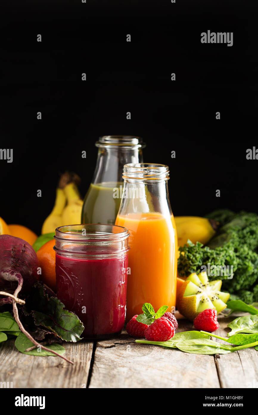 Fresh vegetable and fruit juices with beets, berries, oranges and greens Stock Photo