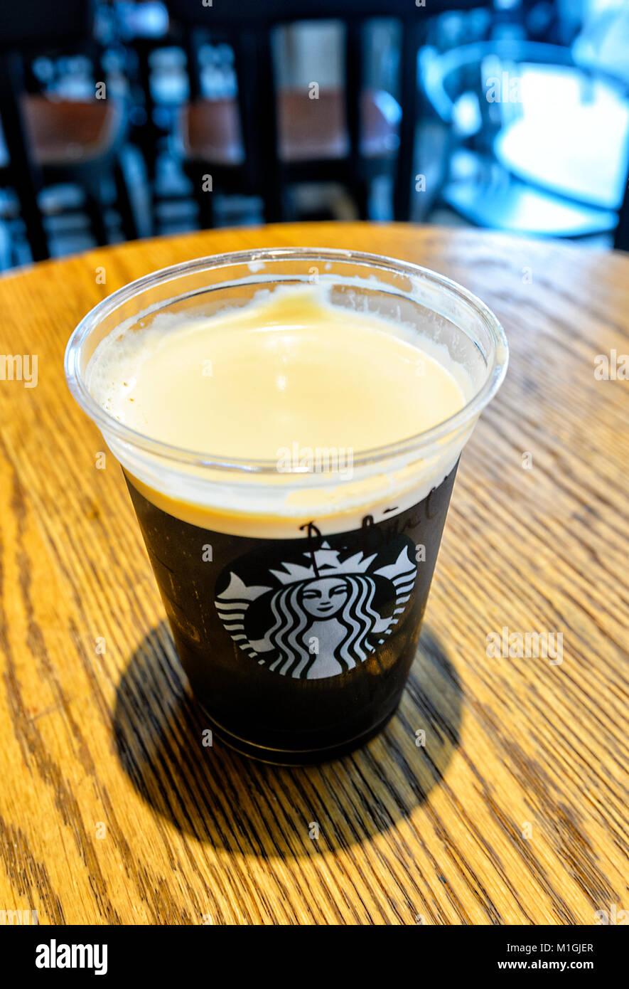 A plastic cup of Nitro Cold Brew Coffee at Starbucks, Kota Kinabalu, Sabah, Borneo, Malaysia - Stock Image