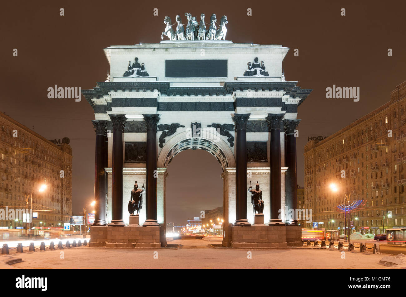 Triumphal Arch of Moscow to commemorate Russia's victory over Napoleon at night. - Stock Image
