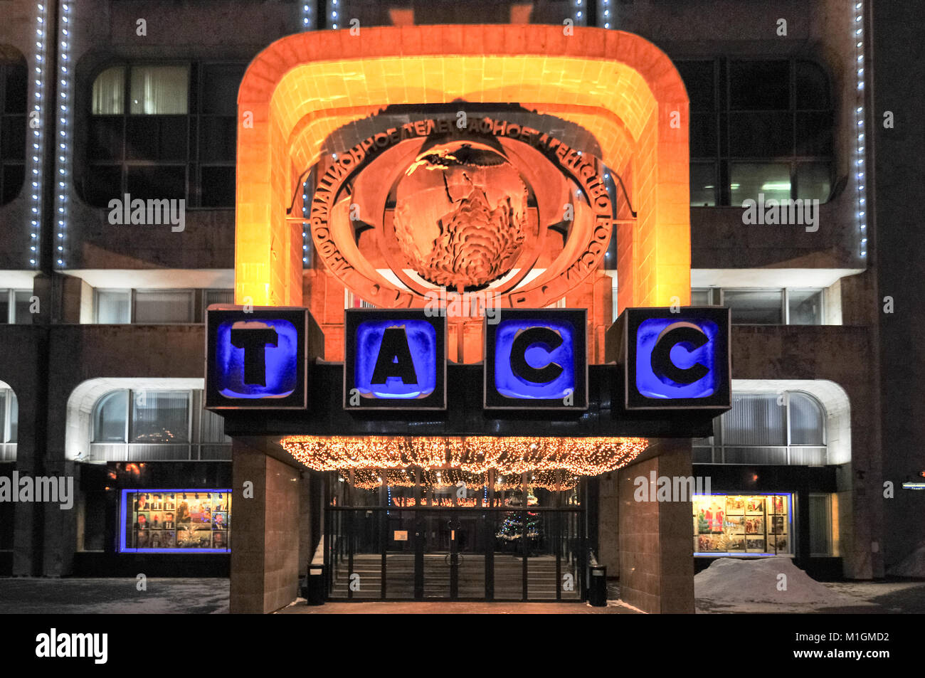 Sign to ITAR-TASS over the entrance to the building at night in Moscow, Russia. - Stock Image