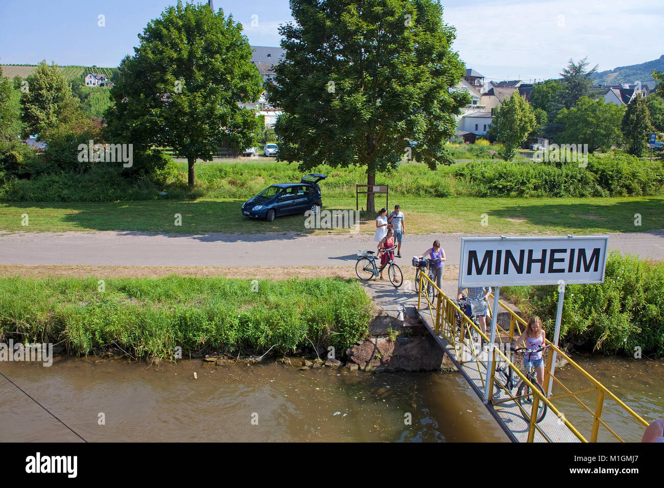 Cyclists boarding at landing stage for excursion ships,Minheim, Moselle river, Rhineland-Palatinate, Germany, Europe Stock Photo