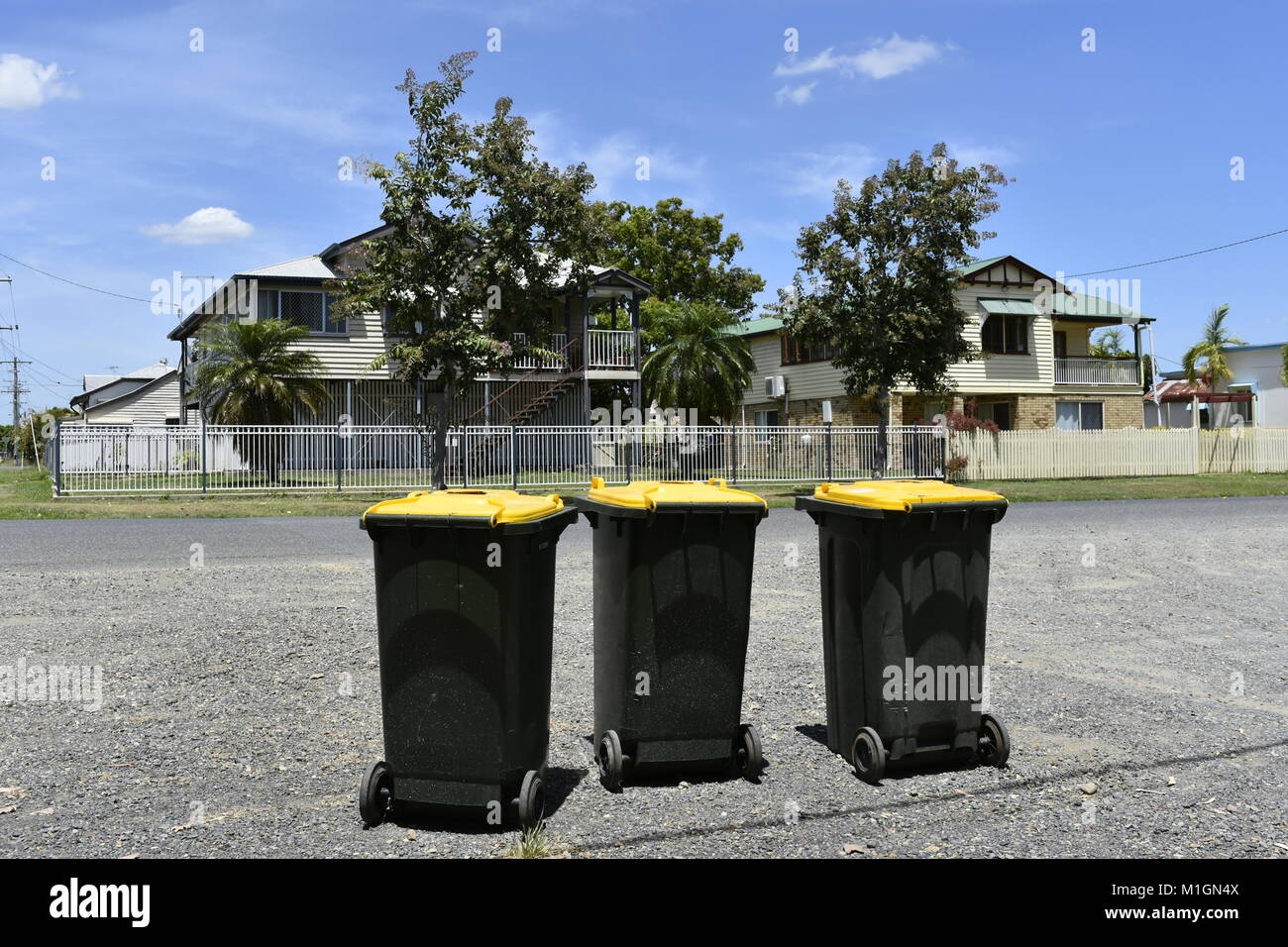 THREE RUBBISH BINS - Stock Image