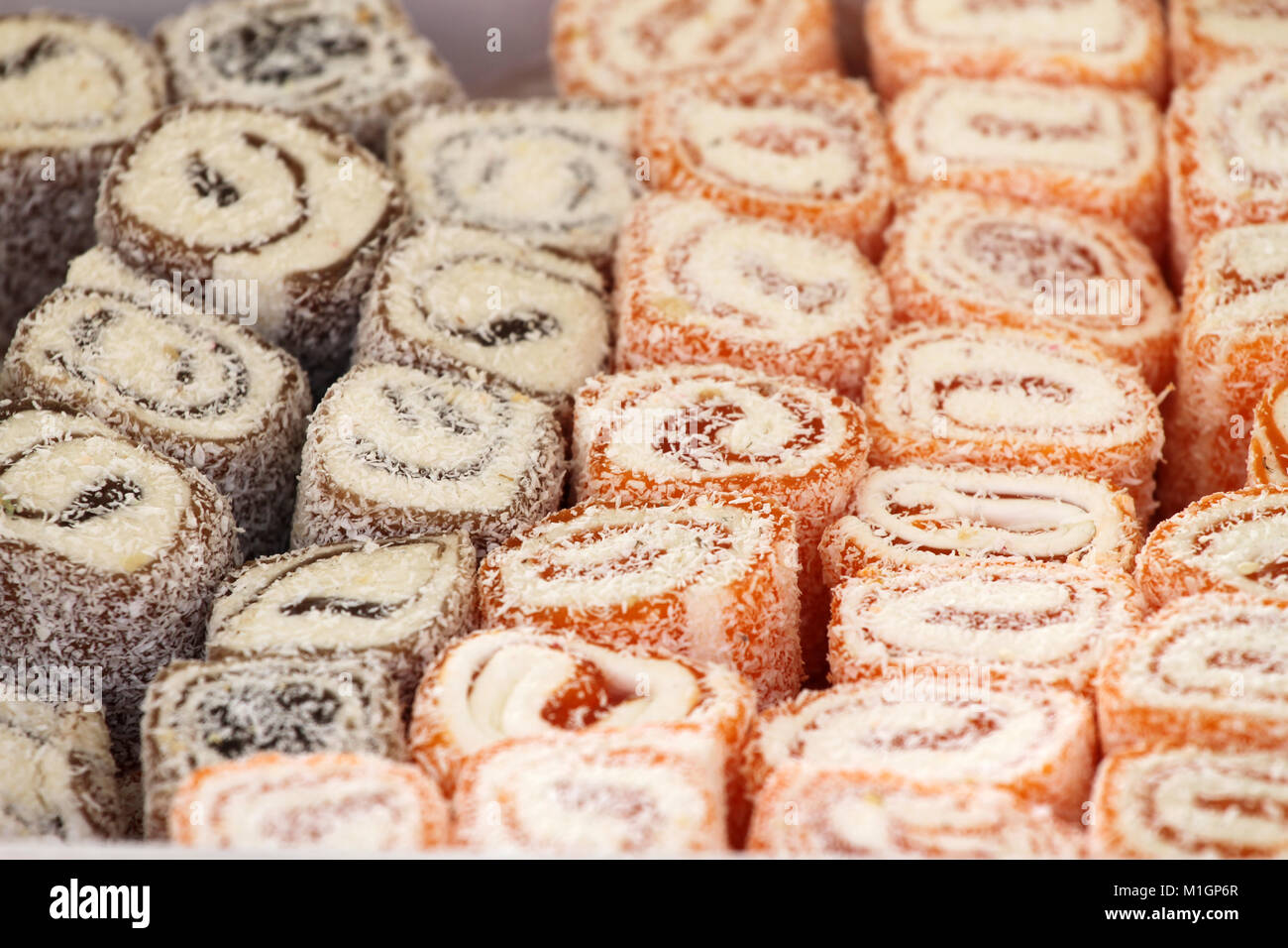 Turkish delight. Lokum. Sweet candies with nuts. turkish delight for dessert. Cezerye or lokum. Turkish candies and sweets, tasty background texture, Stock Photo