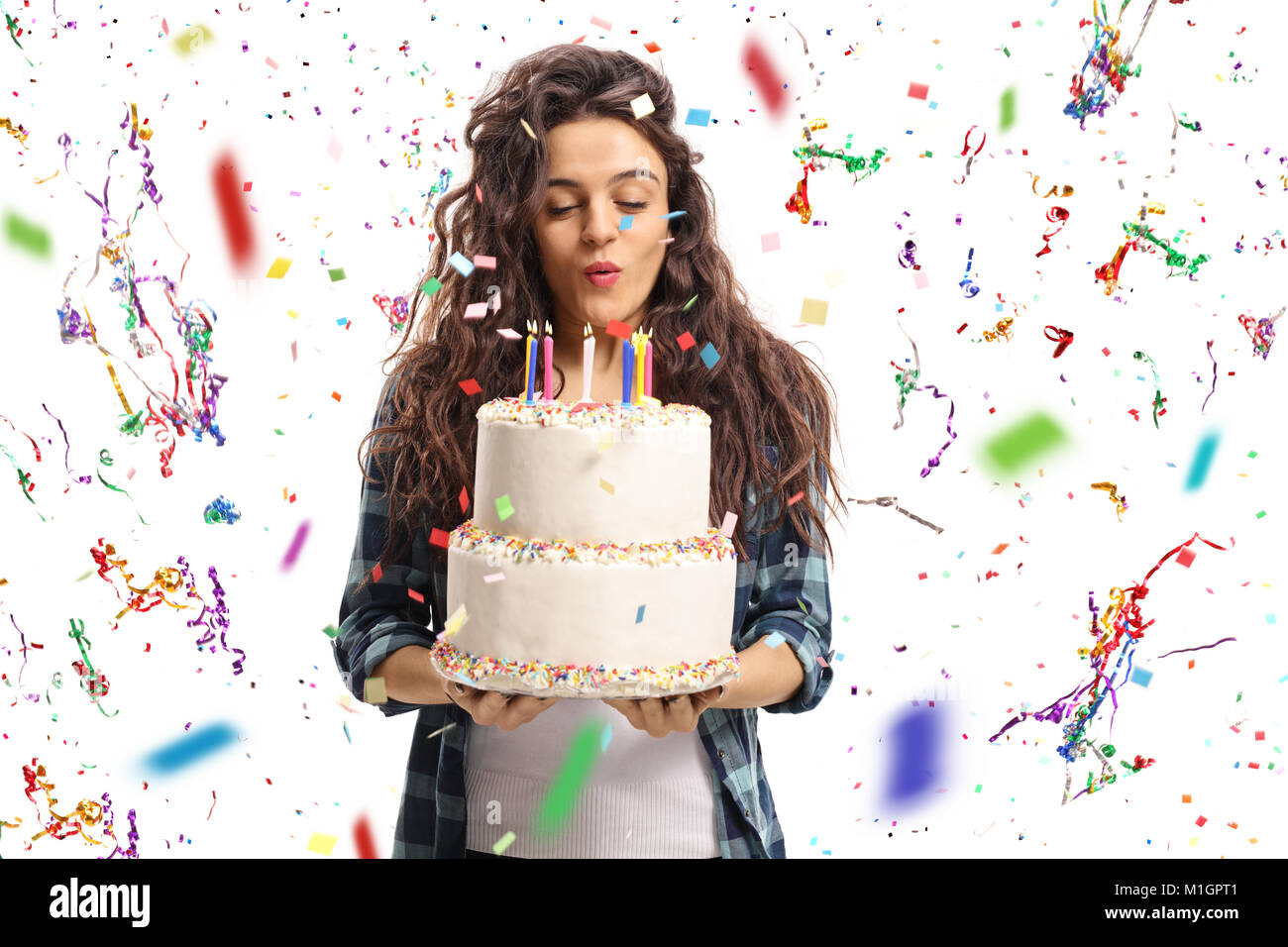 Teenage Girl Blowing Candles On A Birthday Cake With Confetti Stock Photo Alamy