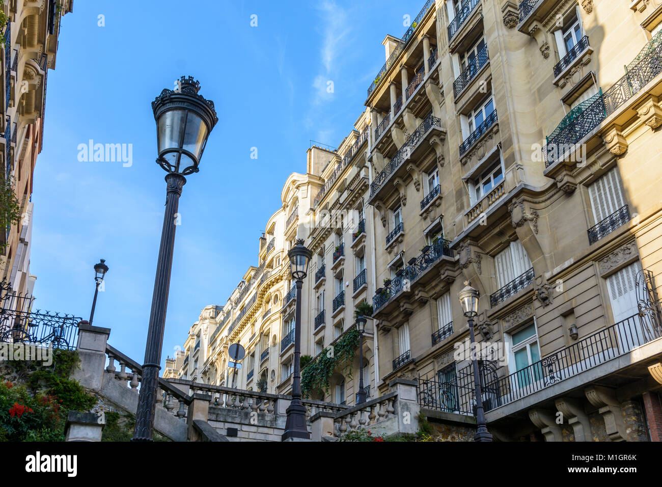 Low angle view of opulent-looking, Haussmannian style buildings in the chic neighborhoods of Paris, with period - Stock Image