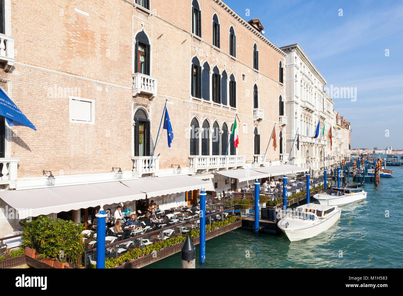 People dining on the terrace of the  luxury Gritti Palace Hotel overlooking the  Grand Canal,  San Marco, Venice, - Stock Image