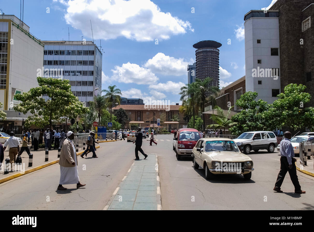 Nairobi Kenya November 3 2008 .Street scene in Nairobi.Cars and  people in street. In background there are buildings, - Stock Image