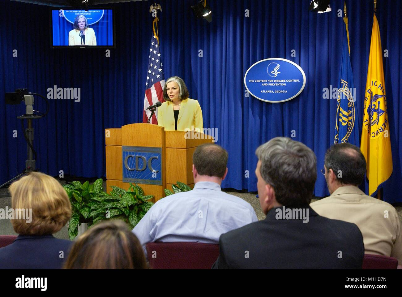 Photograph of Julie Gerberding, former CDC director, speaking in front of a group of reporters at an official press - Stock Image