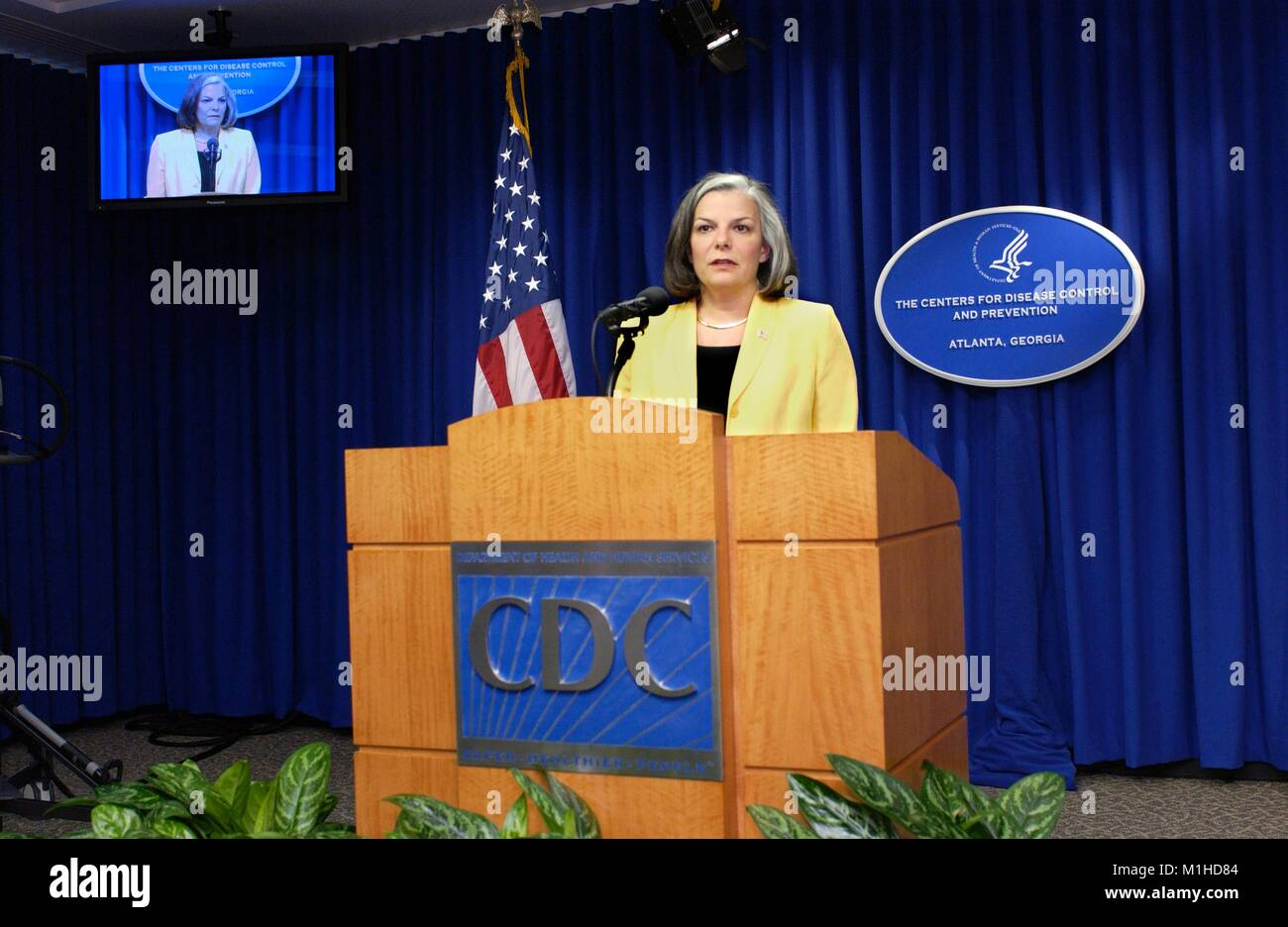 A photograph showing Julie Gerberding, a former CDC director, speaking at a news conference regarding current public - Stock Image