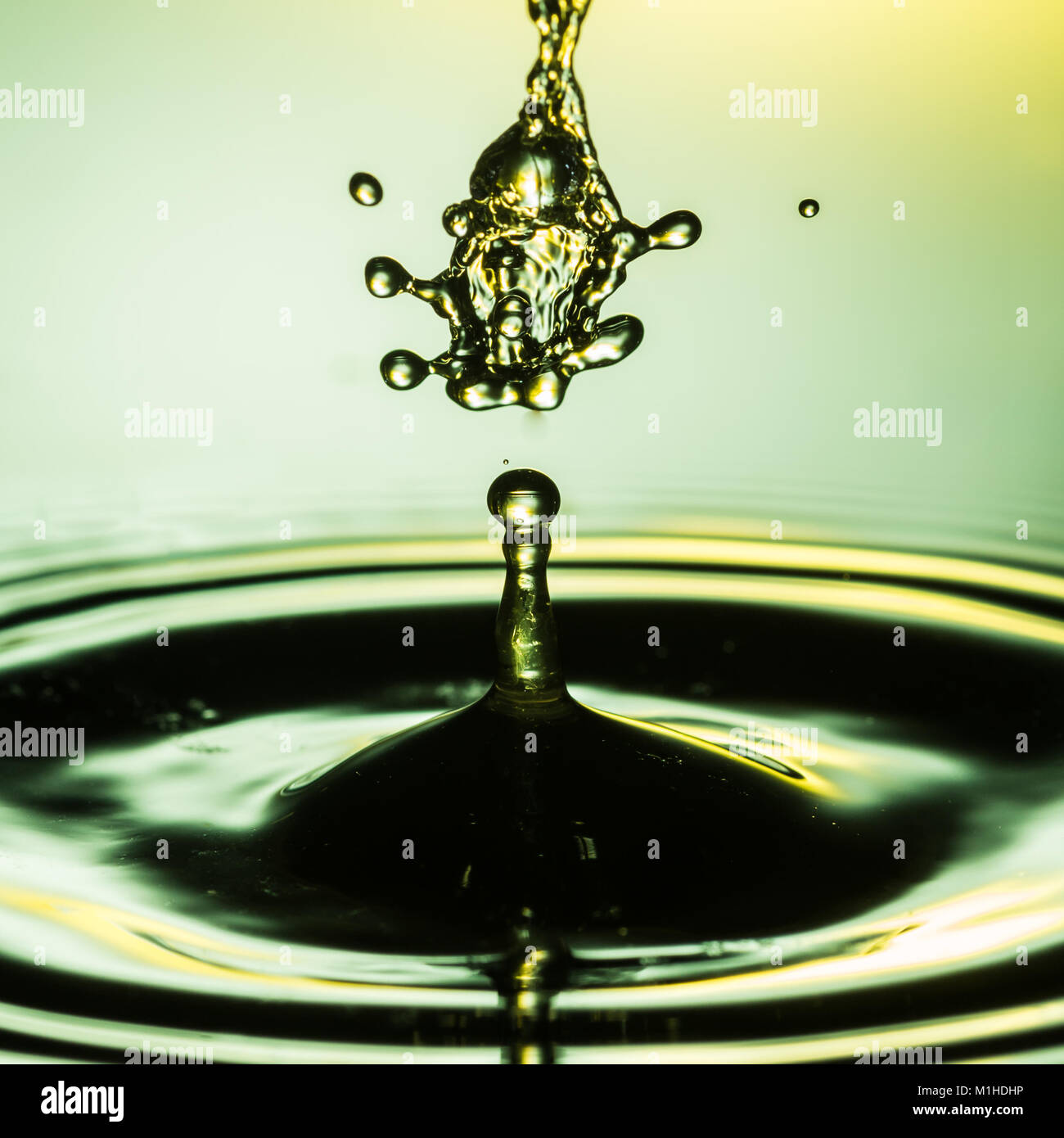 An abstract macro shot of a water drop collision. Stock Photo