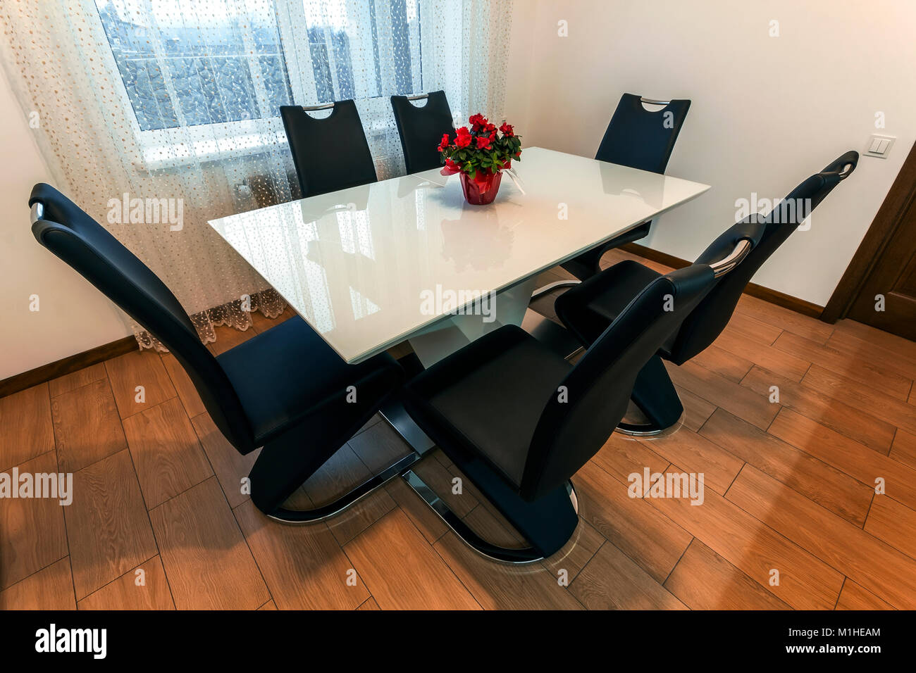 White Wooden And Glass Round Dining Table With Six Chairs Modern Stock Photo Alamy
