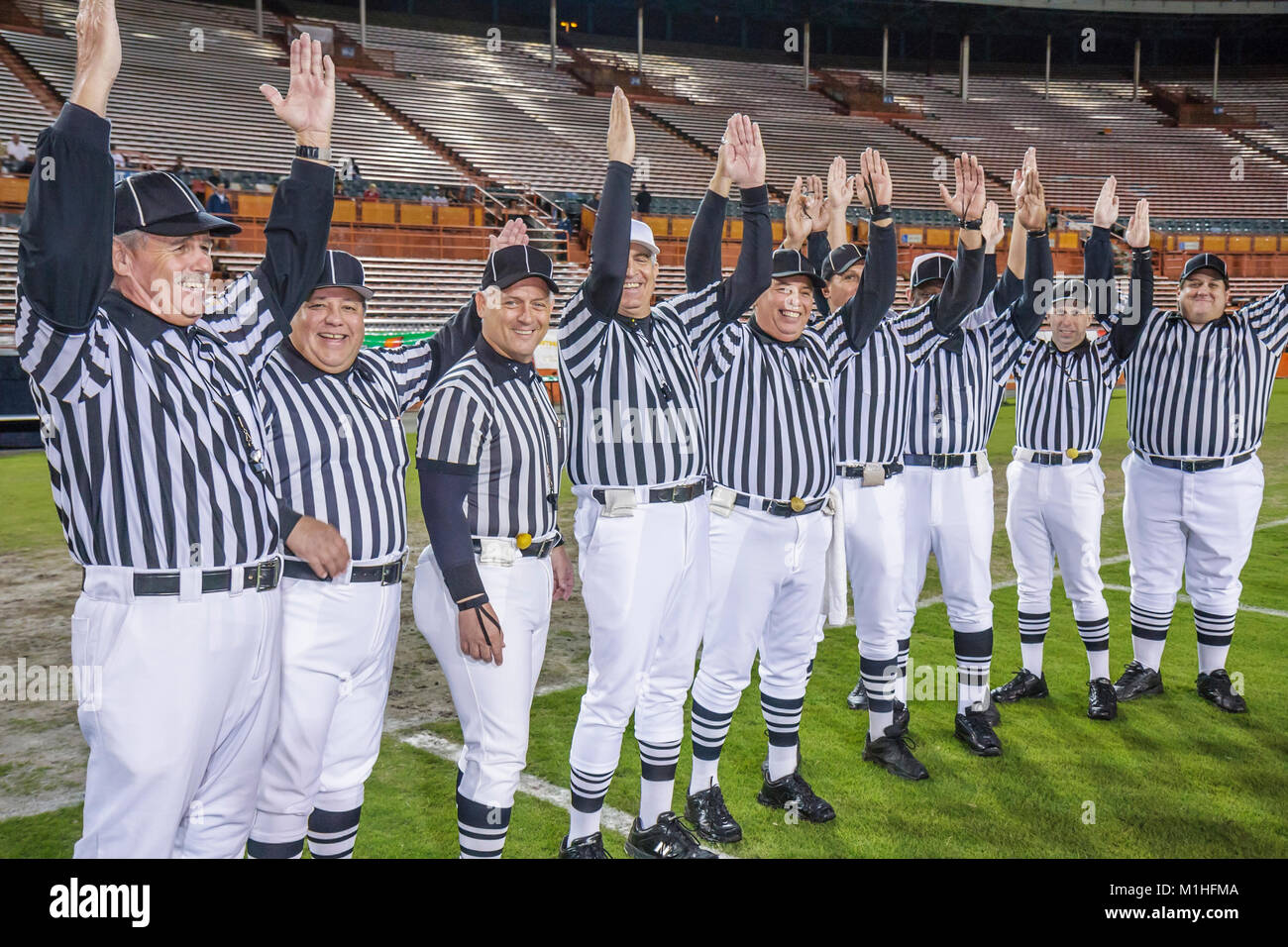 All American Offense Defense Bowl high school football referees officials striped uniforms men man - Stock Image
