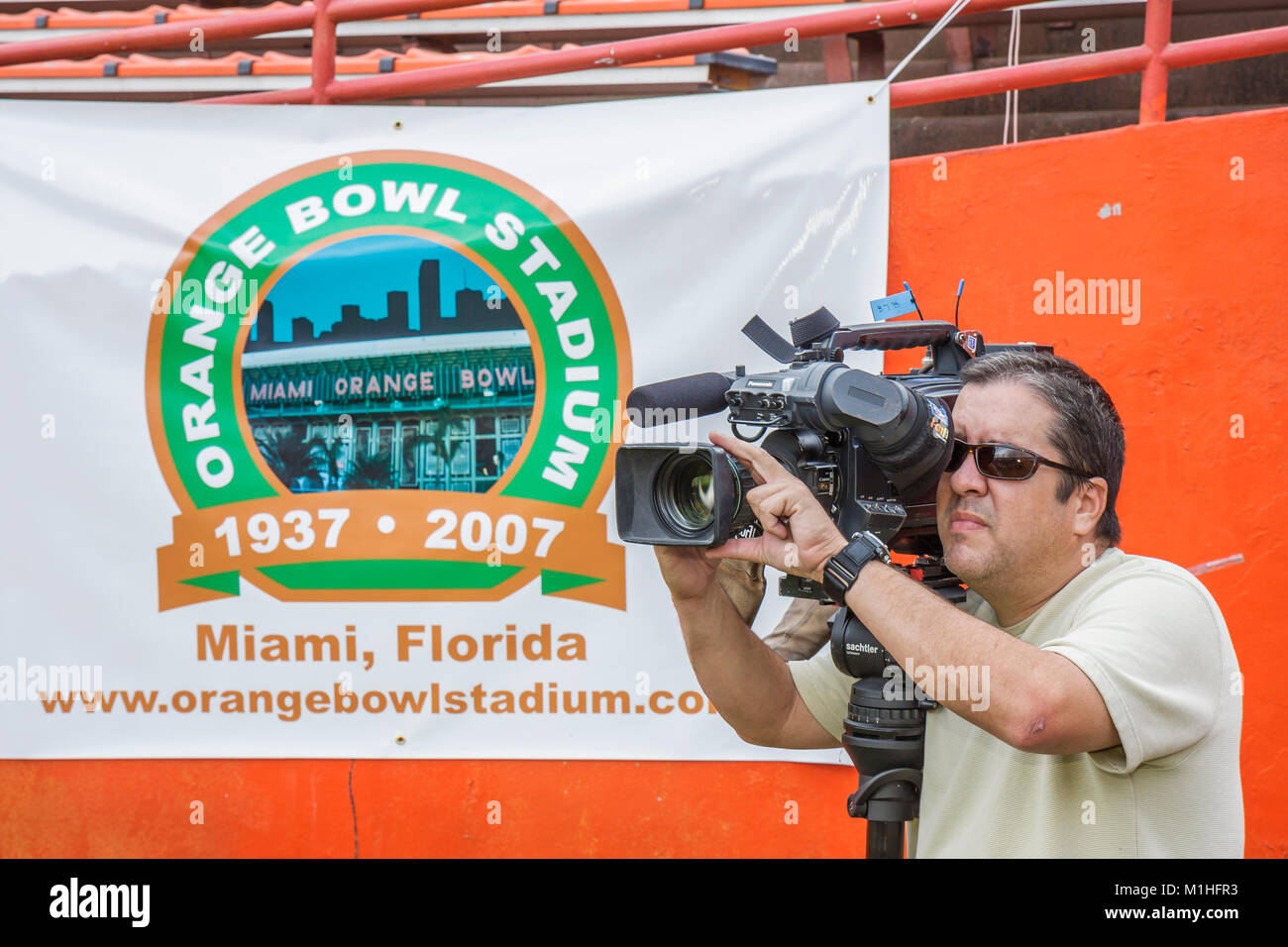 cameraman video cam recorder media Hispanic man banner - Stock Image