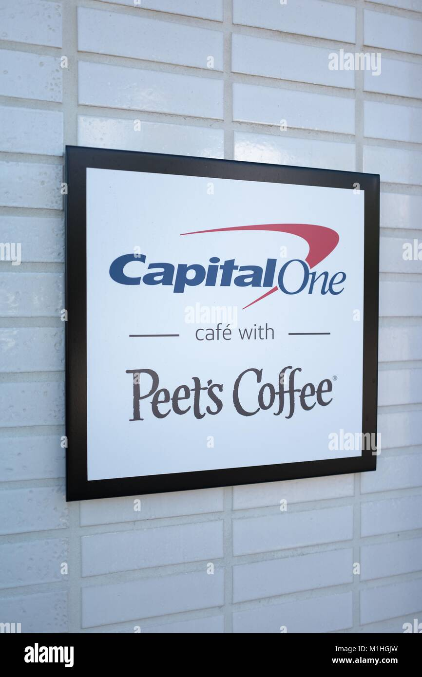 Sign advertising collaboration between CapitalOne bank and Peets Coffee at the CapitalOne Cafe, a combined cafe - Stock Image