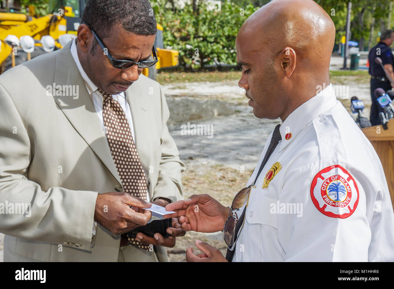 Black man city official fire rescue exchange business cards Stock ...