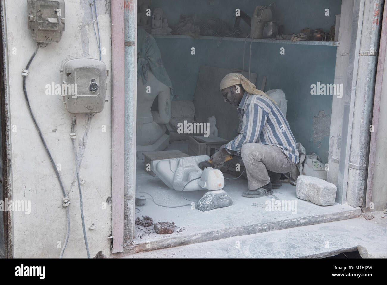 Worker making marble statues, Jaipur, India Stock Photo