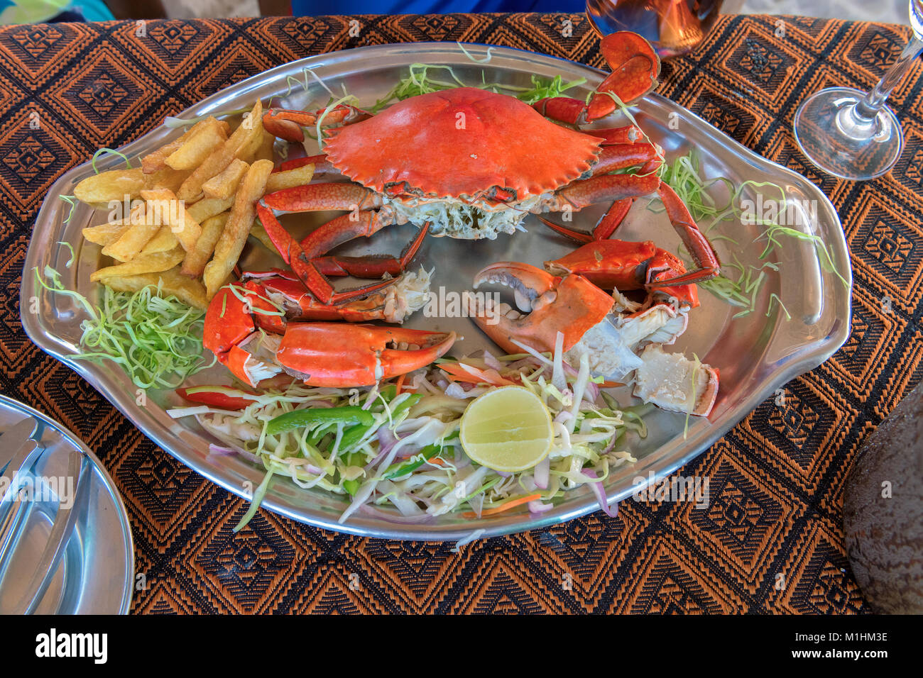 Big crabs and vegetable in beach restaurant, GOA, India. - Stock Image